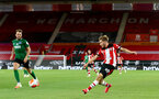 SOUTHAMPTON, ENGLAND - JULY 16: Jake Vokins of southampton during the Premier League match between Southampton FC and Brighton & Hove Albion at St Mary's Stadium on July 16, 2020 in Southampton, United Kingdom. Football Stadiums around Europe remain empty due to the Coronavirus Pandemic as Government social distancing laws prohibit fans inside venues resulting in all fixtures being played behind closed doors. (Photo by Matt Watson/Southampton FC via Getty Images)