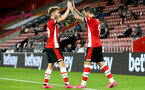 SOUTHAMPTON, ENGLAND - JULY 16: Jake Vokins (L) and Danny Ings (R) celebrating Danny Ings goal during the Premier League match between Southampton FC and Brighton & Hove Albion at St Mary's Stadium on July 16, 2020 in Southampton, United Kingdom. Football Stadiums around Europe remain empty due to the Coronavirus Pandemic as Government social distancing laws prohibit fans inside venues resulting in all fixtures being played behind closed doors. (Photo by Matt Watson/Southampton FC via Getty Images)