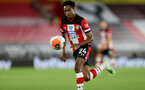 SOUTHAMPTON, ENGLAND - JULY 16: Kyle Walker-Peters of southampton during the Premier League match between Southampton FC and Brighton & Hove Albion at St Mary's Stadium on July 16, 2020 in Southampton, United Kingdom. Football Stadiums around Europe remain empty due to the Coronavirus Pandemic as Government social distancing laws prohibit fans inside venues resulting in all fixtures being played behind closed doors. (Photo by Chris Moorhouse/Southampton FC via Getty Images)