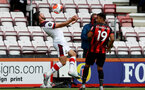 BOURNEMOUTH, ENGLAND - JULY 19: Shane Long (L) of southampton and Junior Stanislas (R) of bournemouth during the Premier League match between AFC Bournemouth and Southampton FC at Vitality Stadium on July 19, 2020 in Bournemouth, United Kingdom. Football Stadiums around Europe remain empty due to the Coronavirus Pandemic as Government social distancing laws prohibit fans inside venues resulting in all fixtures being played behind closed doors. (Photo by Matt Watson/Southampton FC via Getty Images)
