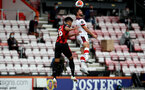 BOURNEMOUTH, ENGLAND - JULY 19: Lloyd Kelly (L) of bournemouth and Shane Long (R) of southampton during the Premier League match between AFC Bournemouth and Southampton FC at Vitality Stadium on July 19, 2020 in Bournemouth, United Kingdom. Football Stadiums around Europe remain empty due to the Coronavirus Pandemic as Government social distancing laws prohibit fans inside venues resulting in all fixtures being played behind closed doors. (Photo by Matt Watson/Southampton FC via Getty Images)