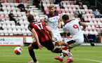 BOURNEMOUTH, ENGLAND - JULY 19: Jack Stacey (L) of bournemouth and Danny Ings (R) of southampton during the Premier League match between AFC Bournemouth and Southampton FC at Vitality Stadium on July 19, 2020 in Bournemouth, United Kingdom. Football Stadiums around Europe remain empty due to the Coronavirus Pandemic as Government social distancing laws prohibit fans inside venues resulting in all fixtures being played behind closed doors. (Photo by Matt Watson/Southampton FC via Getty Images)