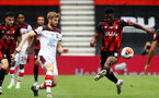 BOURNEMOUTH, ENGLAND - JULY 19: Stuart Armstrong (L) of southampton and Jefferson Lerma (R) of bournemouth during the Premier League match between AFC Bournemouth and Southampton FC at Vitality Stadium on July 19, 2020 in Bournemouth, United Kingdom. Football Stadiums around Europe remain empty due to the Coronavirus Pandemic as Government social distancing laws prohibit fans inside venues resulting in all fixtures being played behind closed doors. (Photo by Matt Watson/Southampton FC via Getty Images)