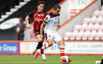 BOURNEMOUTH, ENGLAND - JULY 19: Harry Wilson (L) of bournemouth and Danny Ings (R) of southampton during the Premier League match between AFC Bournemouth and Southampton FC at Vitality Stadium on July 19, 2020 in Bournemouth, United Kingdom. Football Stadiums around Europe remain empty due to the Coronavirus Pandemic as Government social distancing laws prohibit fans inside venues resulting in all fixtures being played behind closed doors. (Photo by Matt Watson/Southampton FC via Getty Images)