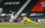 BOURNEMOUTH, ENGLAND - JULY 19: Nathan Redmond (L) of Southampton and Aaron Ramsdale (R) of bournemouth saves Nathan Redmond shot during the Premier League match between AFC Bournemouth and Southampton FC at Vitality Stadium on July 19, 2020 in Bournemouth, United Kingdom. Football Stadiums around Europe remain empty due to the Coronavirus Pandemic as Government social distancing laws prohibit fans inside venues resulting in all fixtures being played behind closed doors. (Photo by Matt Watson/Southampton FC via Getty Images)