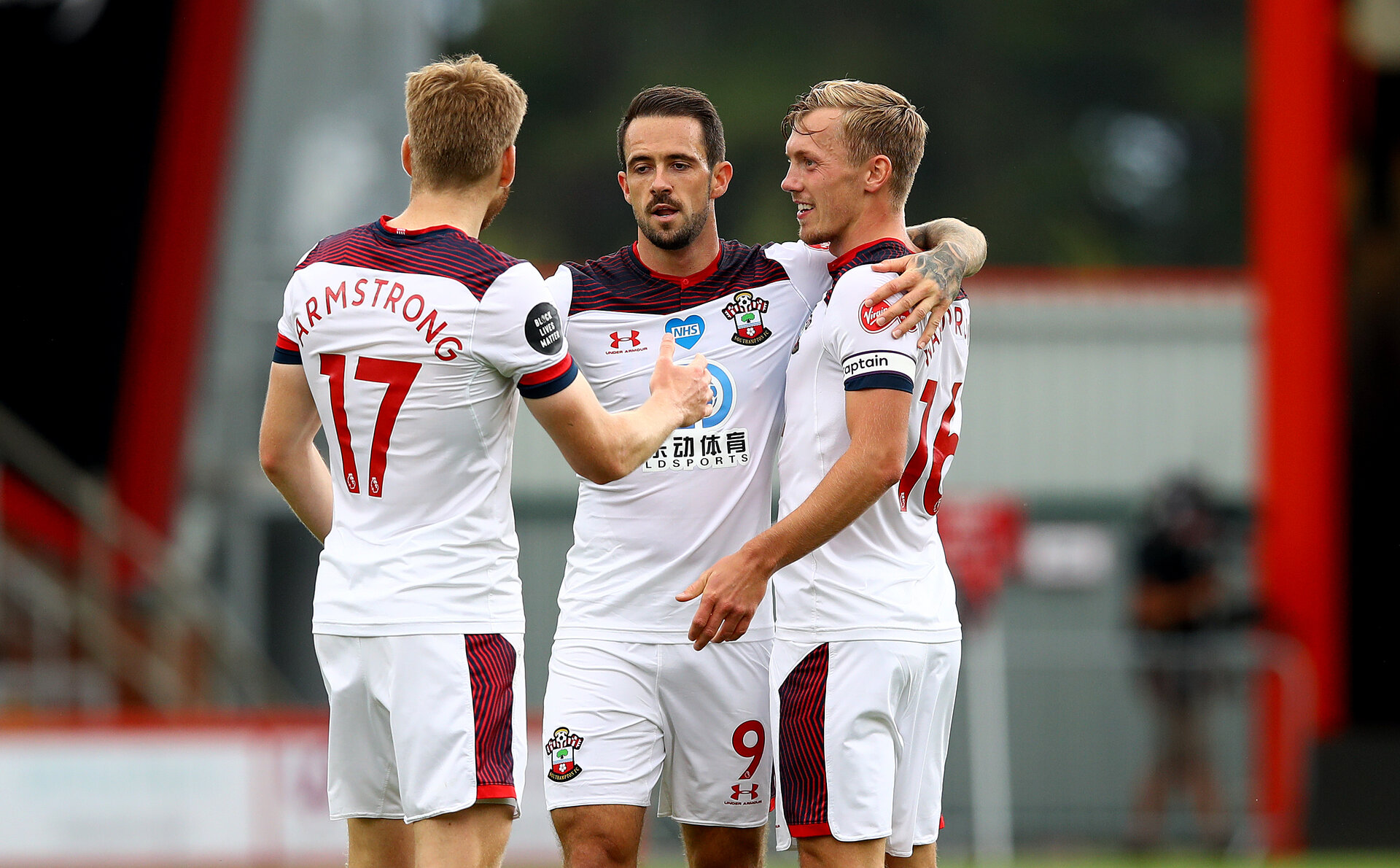 BOURNEMOUTH, ENGLAND - JULY 19: Danny Ings(centre) of Southampton celebrates his goal with Stuart Armstrong(L) and James Ward-Prowse(R) during the Premier League match between AFC Bournemouth and Southampton FC at Vitality Stadium on July 19, 2020 in Bournemouth, United Kingdom. Football Stadiums around Europe remain empty due to the Coronavirus Pandemic as Government social distancing laws prohibit fans inside venues resulting in all fixtures being played behind closed doors. (Photo by Matt Watson/Southampton FC via Getty Images)