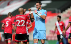 SOUTHAMPTON, ENGLAND - JULY 26: Nathan Redmond (L) and Alex McCarthy (R) ahead of the Premier League match between Southampton FC and Sheffield United at St Mary's Stadium on April 17, 2020 in Southampton, United Kingdom. (Photo by Chris Moorhouse/Southampton FC via Getty Images)