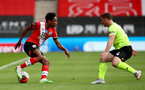 SOUTHAMPTON, ENGLAND - JULY 26: Kyle Walker-Peters (L) of Southampton and John Fleck (R) of Sheffiend during the Premier League match between Southampton FC and Sheffield United at St Mary's Stadium on April 17, 2020 in Southampton, United Kingdom. (Photo by Matt Watson/Southampton FC via Getty Images)