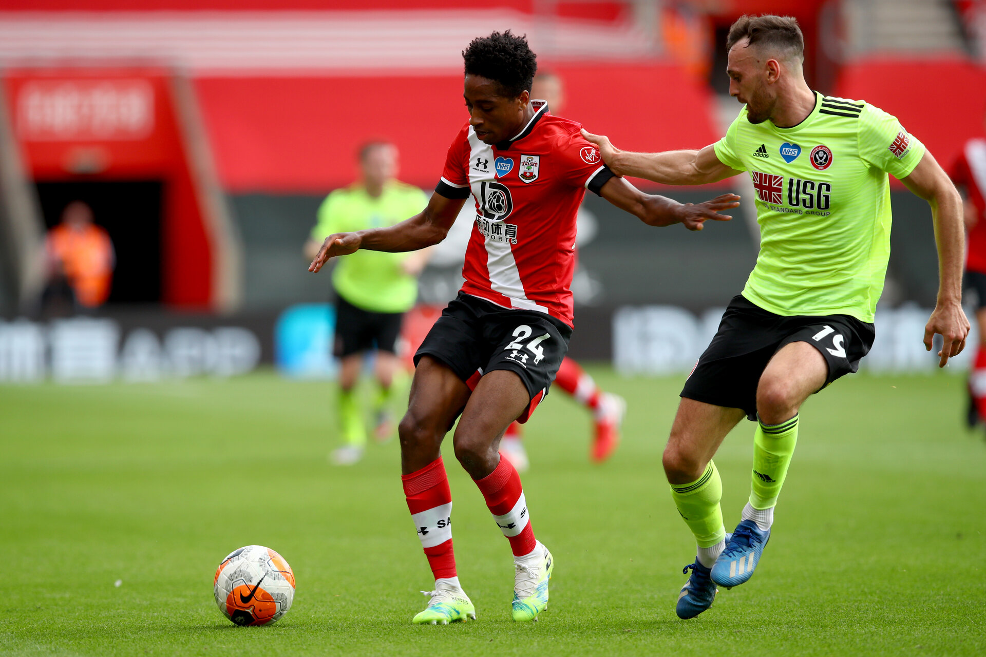 SOUTHAMPTON, ENGLAND - JULY 26: Kyle Walker-Peters (L) of Southampton and Jack Robinson (R) of Sheffield during the Premier League match between Southampton FC and Sheffield United at St Mary's Stadium on April 17, 2020 in Southampton, United Kingdom. (Photo by Matt Watson/Southampton FC via Getty Images)