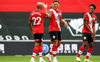 SOUTHAMPTON, ENGLAND - JULY 26: Ché Adams celebrates second goal with team mates during the Premier League match between Southampton FC and Sheffield United at St Mary's Stadium on April 17, 2020 in Southampton, United Kingdom. (Photo by Matt Watson/Southampton FC via Getty Images)