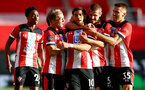 SOUTHAMPTON, ENGLAND - JULY 05: Ché Adams(centre) of Southampton is congratulated by his team mates during the Premier League match between Southampton FC and Manchester City at St Mary's Stadium on July 05, 2020 in Southampton, United Kingdom. Football Stadiums around Europe remain empty due to the Coronavirus Pandemic as Government social distancing laws prohibit fans inside venues resulting in games being played behind closed doors. (Photo by Matt Watson/Southampton FC via Getty Images)