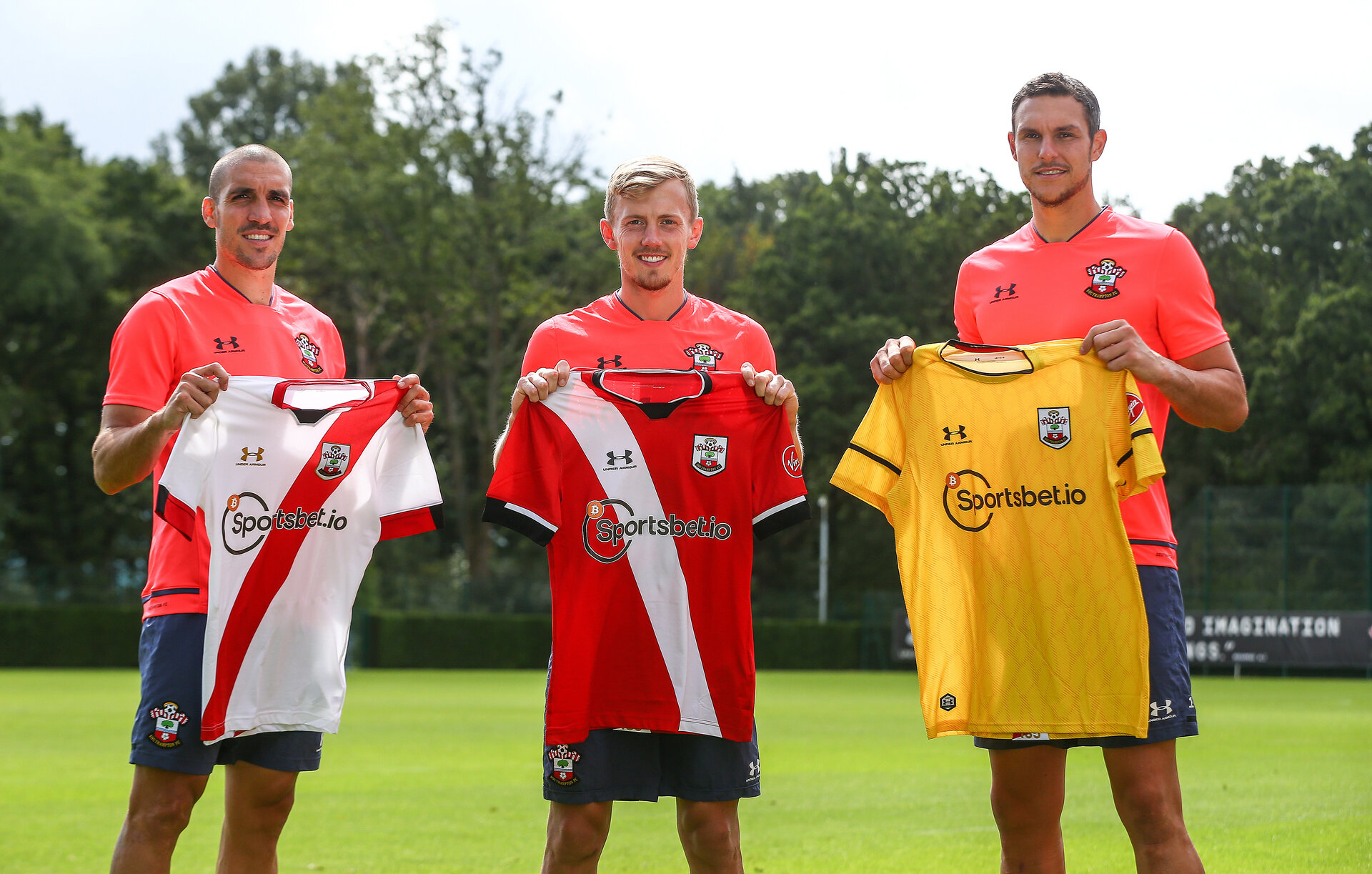 SOUTHAMPTON, ENGLAND - AUGUST 24: Southampton players L to R Oriol Romeu, James Ward-Prowse Alex McCarthy present the 2020/21 shirts with new sponsor Sportsbet.io displayed, pictured at the Staplewood Campus on August 24, 2020 in Southampton, England. (Photo by Matt Watson/Southampton FC via Getty Images)