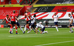 SOUTHAMPTON, ENGLAND - SEPTEMBER 20: Ché Adams(R) of Southampton shoots at goal during the Premier League match between Southampton and Tottenham Hotspur at St Mary's Stadium on September 20, 2020 in Southampton, United Kingdom. (Photo by Matt Watson/Southampton FC via Getty Images)