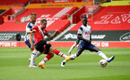 SOUTHAMPTON, ENGLAND - SEPTEMBER 20: Danny Ings of Southampton shoots and scores the opening goal during the Premier League match between Southampton and Tottenham Hotspur at St Mary's Stadium on September 20, 2020 in Southampton, United Kingdom. (Photo by Matt Watson/Southampton FC via Getty Images)