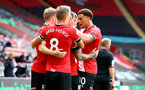 SOUTHAMPTON, ENGLAND - SEPTEMBER 20: Ché Adams(R) congratulates Danny Ings of Southampton during the Premier League match between Southampton and Tottenham Hotspur at St Mary's Stadium on September 20, 2020 in Southampton, United Kingdom. (Photo by Matt Watson/Southampton FC via Getty Images)