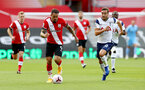 SOUTHAMPTON, ENGLAND - SEPTEMBER 20: Danny Ings(L) of Southampton and Harry Winks (R) of Tottenham Hotspur during the Premier League match between Southampton and Tottenham Hotspur at St Mary's Stadium on September 20, 2020 in Southampton, United Kingdom. (Photo by Matt Watson/Southampton FC via Getty Images)