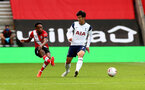 SOUTHAMPTON, ENGLAND - SEPTEMBER 20: Kyle Walker-Peters(L) and Heung-Min Son of Tottenham Hotspur during the Premier League match between Southampton and Tottenham Hotspur at St Mary's Stadium on September 20, 2020 in Southampton, United Kingdom. (Photo by Matt Watson/Southampton FC via Getty Images)