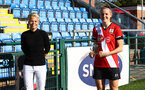 Southampton, ENGLAND - SEPTEMBER 27: Sue Smith (L) presenting Ella Pusey (R) with the player of the match award after the FAWNL match between Southampton Women and Buckland Athletic at Snows Stadium on September 27, 2020 in Southampton, United Kingdom (Photo by Isabelle Field/Southampton FC via Getty Images)
