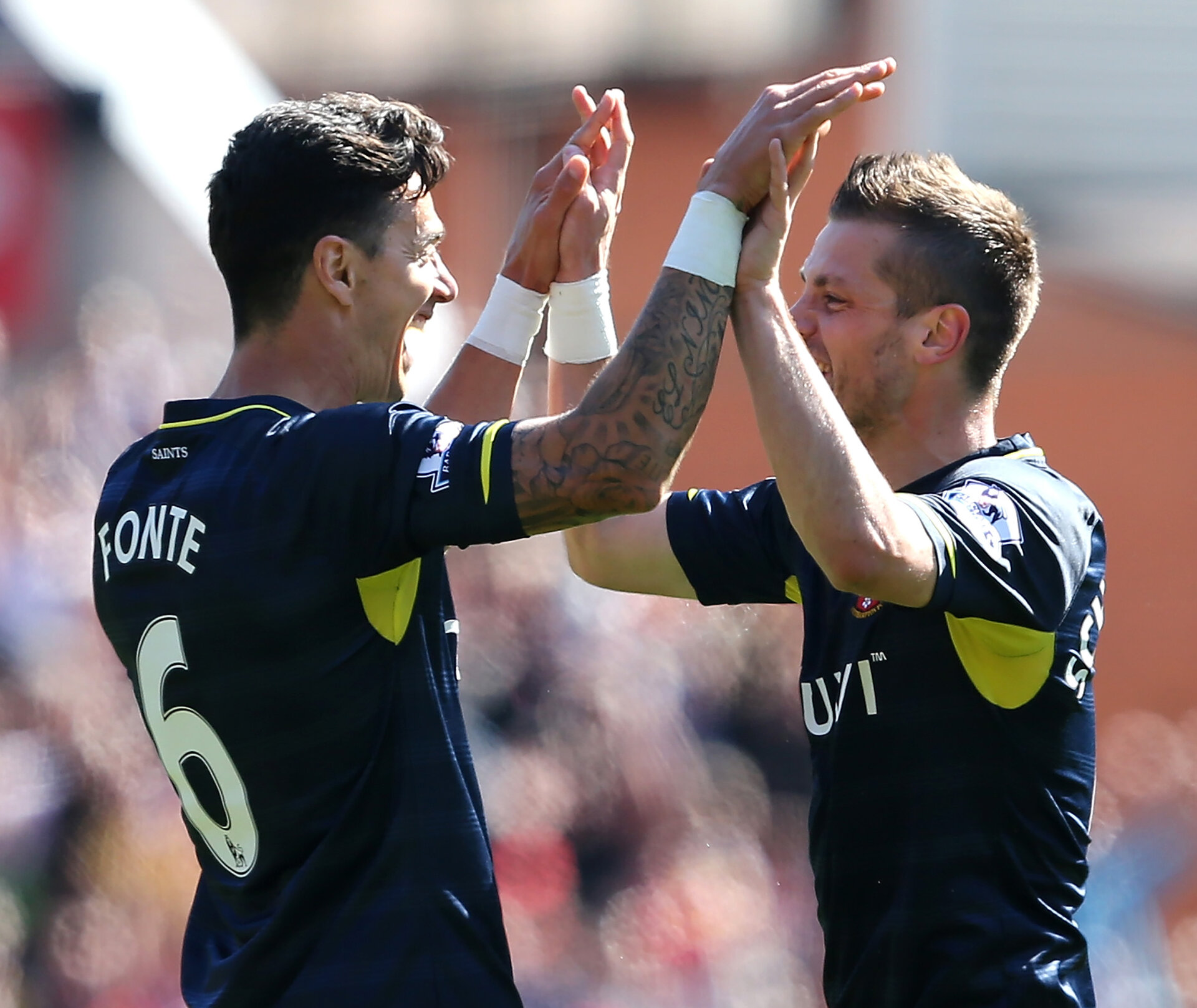 STOKE ON TRENT, ENGLAND - APRIL 18:  Morgan Schneiderlin of Southampton celebrates the first goal with his team-mate Jose Fonte (L) during the Barclays Premier League match between Stoke City and Southampton at the Britannia Stadium on April 18, 2015 in Stoke on Trent, England.  (Photo by Jan Kruger/Getty Images)