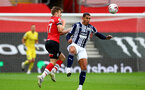 SOUTHAMPTON, ENGLAND - OCTOBER 04: Stuart Armstrong (L) of Southampton and Jake Livermore (R) of West Bromwich Albion during the Premier League match between Southampton and West Bromwich Albion at St Mary's Stadium on October 4, 2020 in Southampton, United Kingdom. Sporting stadiums around the UK remain under strict restrictions due to the Coronavirus Pandemic as Government social distancing laws prohibit fans inside venues resulting in games being played behind closed doors. (Photo by Matt Watson/Southampton FC via Getty Images)
