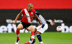 SOUTHAMPTON, ENGLAND - OCTOBER 04: Oriol Romeu (L) of Southampton batteling for the ball against Matheus Diangana (R) of West Bromwich Albion during the Premier League match between Southampton and West Bromwich Albion at St Mary's Stadium on October 4, 2020 in Southampton, United Kingdom. Sporting stadiums around the UK remain under strict restrictions due to the Coronavirus Pandemic as Government social distancing laws prohibit fans inside venues resulting in games being played behind closed doors. (Photo by Matt Watson/Southampton FC via Getty Images)