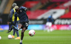 SOUTHAMPTON, ENGLAND - OCTOBER 04: Moussa Djenepo during the Premier League match between Southampton and West Bromwich Albion at St Mary's Stadium on October 4, 2020 in Southampton, United Kingdom. Sporting stadiums around the UK remain under strict restrictions due to the Coronavirus Pandemic as Government social distancing laws prohibit fans inside venues resulting in games being played behind closed doors. (Photo by Chris Moorhouse/Southampton FC via Getty Images)