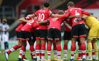 SOUTHAMPTON, ENGLAND - OCTOBER 04: Southampton huddle during the Premier League match between Southampton and West Bromwich Albion at St Mary's Stadium on October 4, 2020 in Southampton, United Kingdom. Sporting stadiums around the UK remain under strict restrictions due to the Coronavirus Pandemic as Government social distancing laws prohibit fans inside venues resulting in games being played behind closed doors. (Photo by Chris Moorhouse/Southampton FC via Getty Images)