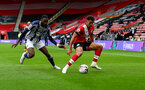 SOUTHAMPTON, ENGLAND - OCTOBER 04: Ché Adams(R) of Southampton during the Premier League match between Southampton and West Bromwich Albion at St Mary's Stadium on October 04, 2020 in Southampton, United Kingdom. Sporting stadiums around the UK remain under strict restrictions due to the Coronavirus Pandemic as Government social distancing laws prohibit fans inside venues resulting in games being played behind closed doors. (Photo by Matt Watson/Southampton FC via Getty Images)