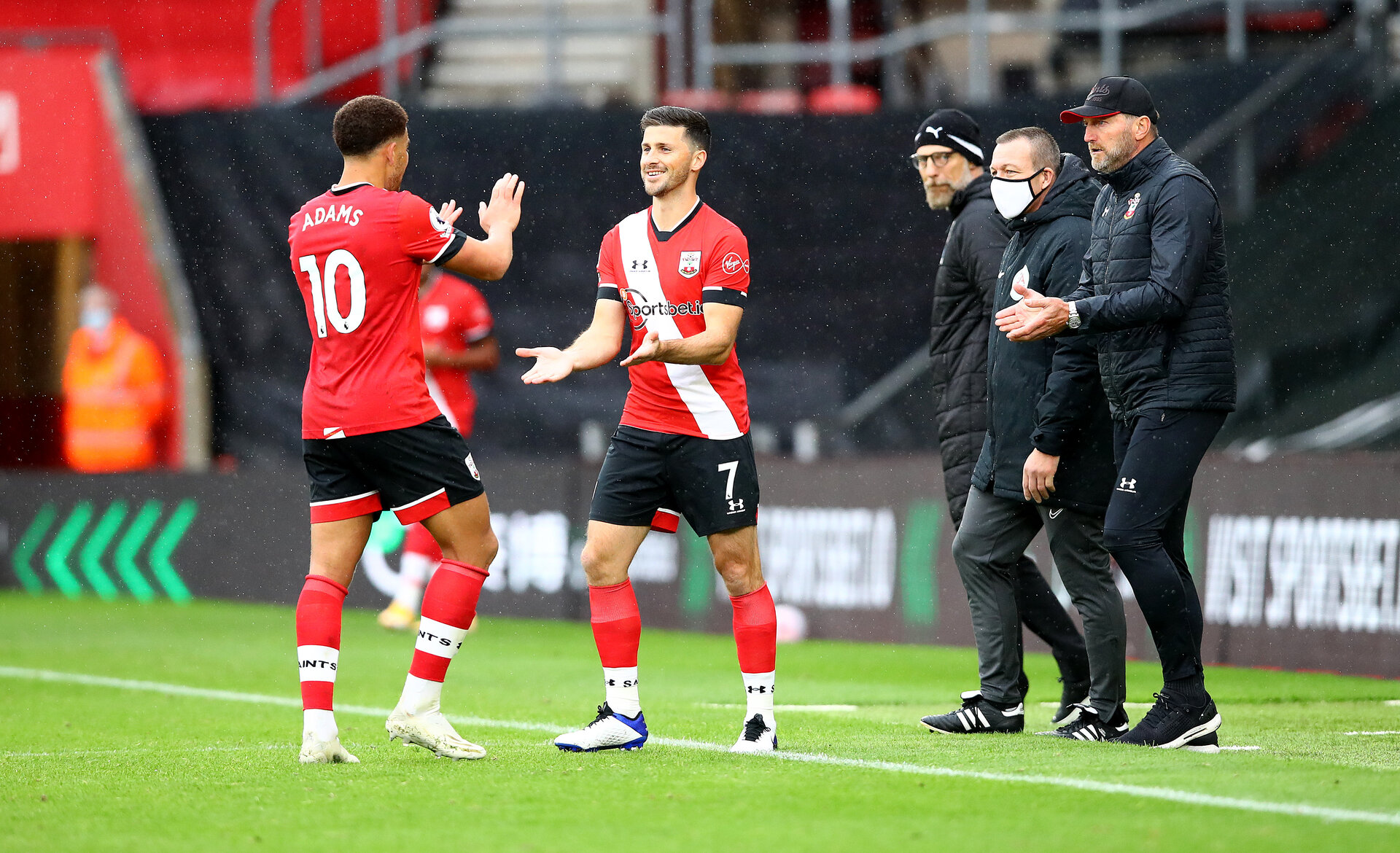 SOUTHAMPTON, ENGLAND - OCTOBER 04: Shane Long(R) of Southampton comes on for Ché Adams(L) during the Premier League match between Southampton and West Bromwich Albion at St Mary's Stadium on October 04, 2020 in Southampton, United Kingdom. Sporting stadiums around the UK remain under strict restrictions due to the Coronavirus Pandemic as Government social distancing laws prohibit fans inside venues resulting in games being played behind closed doors. (Photo by Matt Watson/Southampton FC via Getty Images)