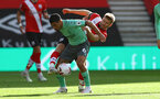 SOUTHAMPTON, ENGLAND - OCTOBER 25: Allan(L) of Everton and Stuart Armstrong(R) of Southampton during the Premier League match between Southampton and Everton at St Mary's Stadium on October 25, 2020 in Southampton, England. Sporting stadiums around the UK remain under strict restrictions due to the Coronavirus Pandemic as Government social distancing laws prohibit fans inside venues resulting in games being played behind closed doors. (Photo by Matt Watson/Southampton FC via Getty Images)