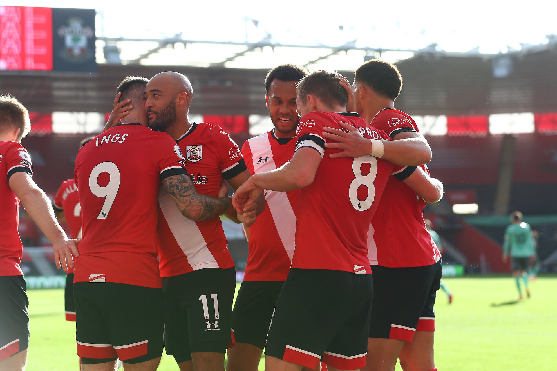 SOUTHAMPTON, ENGLAND - OCTOBER 25: Southampton players congratulate James Ward-Prowse of Southampton on his goal  during the Premier League match between Southampton and Everton at St Mary's Stadium on October 25, 2020 in Southampton, England. Sporting stadiums around the UK remain under strict restrictions due to the Coronavirus Pandemic as Government social distancing laws prohibit fans inside venues resulting in games being played behind closed doors. (Photo by Matt Watson/Southampton FC via Getty Images)