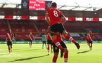 SOUTHAMPTON, ENGLAND - OCTOBER 25: Danny Ings(L) of Southampton celebrates James Ward-Prowse(R) of Southampton goal during the Premier League match between Southampton and Everton at St Mary's Stadium on October 25, 2020 in Southampton, England. Sporting stadiums around the UK remain under strict restrictions due to the Coronavirus Pandemic as Government social distancing laws prohibit fans inside venues resulting in games being played behind closed doors. (Photo by Matt Watson/Southampton FC via Getty Images)