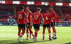 SOUTHAMPTON, ENGLAND - OCTOBER 25: Southampton players congratulate Ché Adams on his goal during the Premier League match between Southampton and Everton at St Mary's Stadium on October 25, 2020 in Southampton, England. Sporting stadiums around the UK remain under strict restrictions due to the Coronavirus Pandemic as Government social distancing laws prohibit fans inside venues resulting in games being played behind closed doors. (Photo by Matt Watson/Southampton FC via Getty Images)