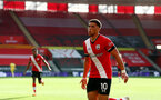 SOUTHAMPTON, ENGLAND - OCTOBER 25: Che Adams of Southampton celebrates after scoring his teams' second goal during the Premier League match between Southampton and Everton at St Mary's Stadium on October 25, 2020 in Southampton, England. Sporting stadiums around the UK remain under strict restrictions due to the Coronavirus Pandemic as Government social distancing laws prohibit fans inside venues resulting in games being played behind closed doors. (Photo by Matt Watson/Southampton FC via Getty Images)