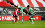 SOUTHAMPTON, ENGLAND - OCTOBER 25: Kyle Walker-Peters(L) of Southampton is fouled by Lucas Digne(R) of Everton, who is then shown a red card during the Premier League match between Southampton and Everton at St Mary's Stadium on October 25, 2020 in Southampton, England. Sporting stadiums around the UK remain under strict restrictions due to the Coronavirus Pandemic as Government social distancing laws prohibit fans inside venues resulting in games being played behind closed doors. (Photo by Matt Watson/Southampton FC via Getty Images)