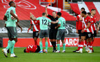 SOUTHAMPTON, ENGLAND - OCTOBER 25: Referee Kevin Friend shows a red card to Lucas Digne of Everton during the Premier League match between Southampton and Everton at St Mary's Stadium on October 25, 2020 in Southampton, England. Sporting stadiums around the UK remain under strict restrictions due to the Coronavirus Pandemic as Government social distancing laws prohibit fans inside venues resulting in games being played behind closed doors. (Photo by Matt Watson/Southampton FC via Getty Images)