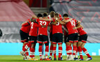 SOUTHAMPTON, ENGLAND - NOVEMBER 06: Southampton players huddle ahead of  the Premier League match between Southampton and Newcastle United at St Mary's Stadium on November 06, 2020 in Southampton, England. Sporting stadiums around the UK remain under strict restrictions due to the Coronavirus Pandemic as Government social distancing laws prohibit fans inside venues resulting in games being played behind closed doors. (Photo by Matt Watson/Southampton FC via Getty Images)