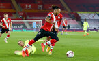 SOUTHAMPTON, ENGLAND - NOVEMBER 06: Miguel Almiron(L) of Newcastle unable to stop Theo Walcott(R) of Southampton during the Premier League match between Southampton and Newcastle United at St Mary's Stadium on November 06, 2020 in Southampton, England. Sporting stadiums around the UK remain under strict restrictions due to the Coronavirus Pandemic as Government social distancing laws prohibit fans inside venues resulting in games being played behind closed doors. (Photo by Matt Watson/Southampton FC via Getty Images)