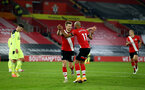 SOUTHAMPTON, ENGLAND - NOVEMBER 06: Stuart Armstrong(L) of Southampton celebrates with team mate Nathan Redmond(R) after scoring to make 2-0 during the Premier League match between Southampton and Newcastle United at St Mary's Stadium on November 06, 2020 in Southampton, England. Sporting stadiums around the UK remain under strict restrictions due to the Coronavirus Pandemic as Government social distancing laws prohibit fans inside venues resulting in games being played behind closed doors. (Photo by Matt Watson/Southampton FC via Getty Images)