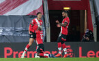 SOUTHAMPTON, ENGLAND - NOVEMBER 06: Che Adams' goal celebration during the Premier League match between Southampton and Newcastle United at St Mary's Stadium on November 6, 2020 in Southampton, United Kingdom. Sporting stadiums around the UK remain under strict restrictions due to the Coronavirus Pandemic as Government social distancing laws prohibit fans inside venues resulting in games being played behind closed doors. (Photo by Chris Moorhouse/Southampton FC via Getty Images)