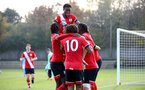 SOUTHAMPTON, ENGLAND - NOVEMBER 07: Southampton players surround Jake Vokins after he scores during the Premier League 2 match between Southampton FC B Team and Manchester City at Staplewood Training Ground on November 07, 2020 in Southampton, England. (Photo by Isabelle Field/Southampton FC via Getty Images) (Photo by Isabelle Field/Isabelle Field)