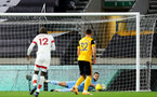 WOLVERHAMPTON, ENGLAND - NOVEMBER 23: Alex McCarthy of Southampton stops Wolves from taking the lead during the Premier League match between Wolverhampton Wanderers and Southampton at Molineux on November 23, 2020 in Wolverhampton, England. Sporting stadiums around the UK remain under strict restrictions due to the Coronavirus Pandemic as Government social distancing laws prohibit fans inside venues resulting in games being played behind closed doors. (Photo by Matt Watson/Southampton FC via Getty Images)