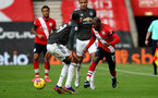 SOUTHAMPTON, ENGLAND - NOVEMBER 29: Moussa Djenepo(R) of Southampton during the Premier League match between Southampton and Manchester United at St Mary's Stadium on November 29, 2020 in Southampton, England. Sporting stadiums around the UK remain under strict restrictions due to the Coronavirus Pandemic as Government social distancing laws prohibit fans inside venues resulting in games being played behind closed doors. (Photo by Matt Watson/Southampton FC via Getty Images)