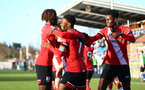 SOUTHAMPTON, ENGLAND - DECEMBER 12: Nathan Tella of Southampton celebrates goal with team mates during the Premier League 2 match between Southampton B Team and Leicester City at Snows Stadium on December 12, 2020 in Southampton, England. (Photo by Isabelle Field/Southampton FC via Getty Images)