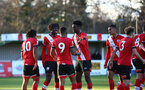 SOUTHAMPTON, ENGLAND - DECEMBER 12: Tyreke Johnson of Southampton celebrates scoring with team mates during the Premier League 2 match between Southampton B Team and Leicester City at Snows Stadium on December 12, 2020 in Southampton, England. (Photo by Isabelle Field/Southampton FC via Getty Images)
