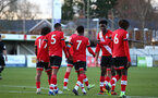 SOUTHAMPTON, ENGLAND - DECEMBER 12: Southampton players celebrate Nathan Tella goal during the Premier League 2 match between Southampton B Team and Leicester City at Snows Stadium on December 12, 2020 in Southampton, England. (Photo by Isabelle Field/Southampton FC via Getty Images)