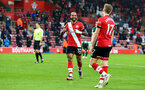 SOUTHAMPTON, ENGLAND - DECEMBER 13: Theo Walcott(L) of Southampton celebrates with Stuart Armstrong(R) after Stuart Armstrong scores to make it 2-0 during the Premier League match between Southampton and Sheffield United at St Mary's Stadium on December 13, 2020 in Southampton, England. A limited number of spectators (2000) are welcomed back to stadiums to watch elite football across England. This was following easing of restrictions on spectators in tiers one and two areas only. (Photo by Matt Watson/Southampton FC via Getty Images)