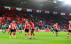 SOUTHAMPTON, ENGLAND - DECEMBER 13: Stuart Armstrong(17) of Southampton celebrates with his team mates during the Premier League match between Southampton and Sheffield United at St Mary's Stadium on December 13, 2020 in Southampton, England. A limited number of spectators (2000) are welcomed back to stadiums to watch elite football across England. This was following easing of restrictions on spectators in tiers one and two areas only. (Photo by Matt Watson/Southampton FC via Getty Images)