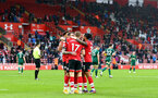 SOUTHAMPTON, ENGLAND - DECEMBER 13: Southampton players celebrate after Stuart Armstrong makes it 2-0 during the Premier League match between Southampton and Sheffield United at St Mary's Stadium on December 13, 2020 in Southampton, England. A limited number of spectators (2000) are welcomed back to stadiums to watch elite football across England. This was following easing of restrictions on spectators in tiers one and two areas only. (Photo by Matt Watson/Southampton FC via Getty Images)