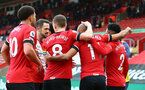 SOUTHAMPTON, ENGLAND - DECEMBER 13: Nathan Redmond(11) celebrates with team mates after scoring during the Premier League match between Southampton and Sheffield United at St Mary's Stadium on December 13, 2020 in Southampton, England. A limited number of spectators (2000) are welcomed back to stadiums to watch elite football across England. This was following easing of restrictions on spectators in tiers one and two areas only. (Photo by Matt Watson/Southampton FC via Getty Images)